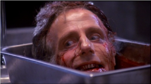Ator David Gale, interpretando uma cabeça decepada morta-viva, Shot do Filme Re-animator (Hora dos Mortos-Vivos) de Stuart Gordon, 1985.